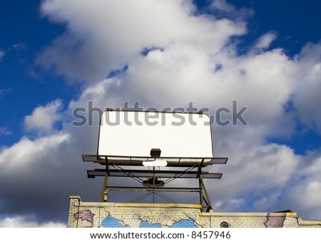 Place your text here - empty ad space in the sky with clouds and brick wall in Downtown Toronto horizontal - stock photo