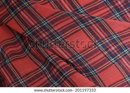 Plaid Fabric Background Plaid fabric ideal for a Christmas or Scottish themed background.  - stock photo