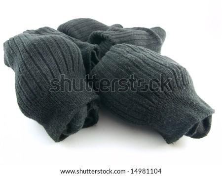 Plain Black Rolled Up Work Socks on White Background - stock photo