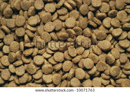 Plain brown dog food background - stock photo