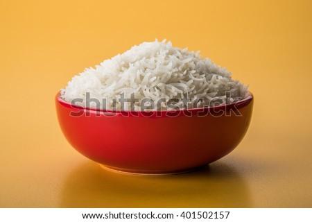 Plain white cooked basmati rice in a ceramic bowl - stock photo