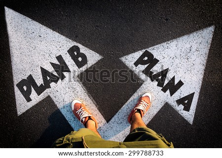 Plan A and Plan B dilemma concept with man legs from above standing on signs - stock photo