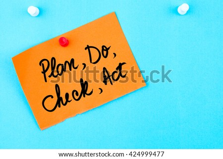 Plan, Do, Check, Act written on orange paper note pinned on cork board with white thumbtack, copy space available - stock photo