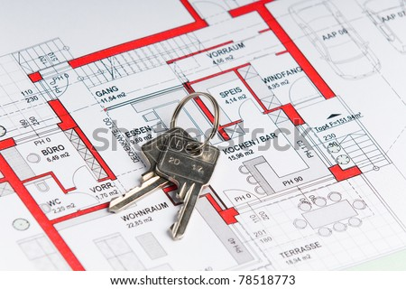 plan of a house with a key on it - stock photo