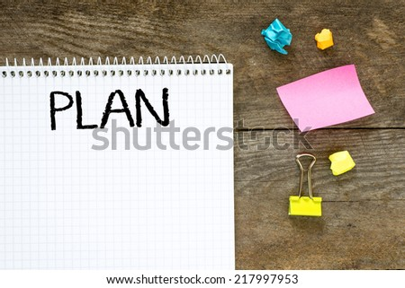 Plan on note paper. Planon note paper on table board with sticky notes. - stock photo