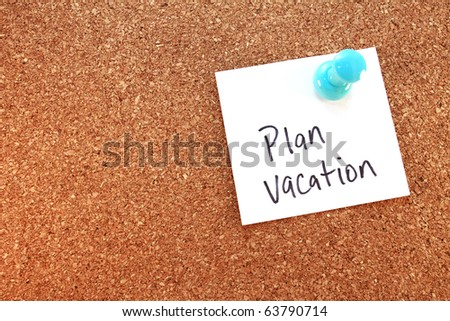 Plan Vacation A plan vacation note tacked on corkboard. Horizontal. - stock photo