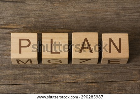 PLAN word on a wooden background - stock photo