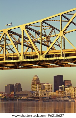 Plane above Louisville, Kentucky - stock photo