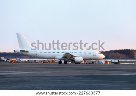 Plane at on airport - stock photo