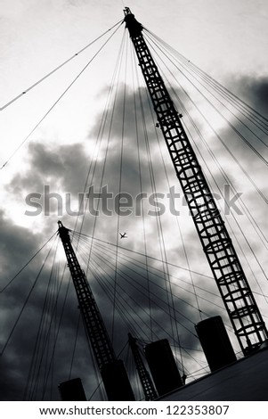 Plane flying over Millennium Dome - stock photo