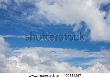 plane in the cloudy sky - stock photo
