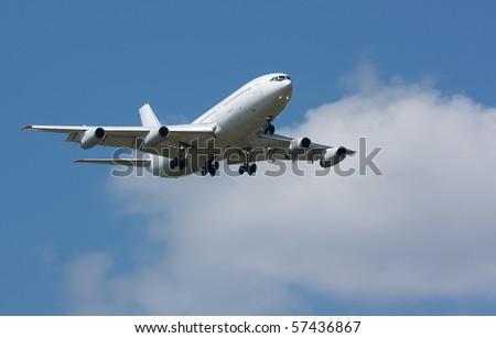 Plane in the sky - stock photo