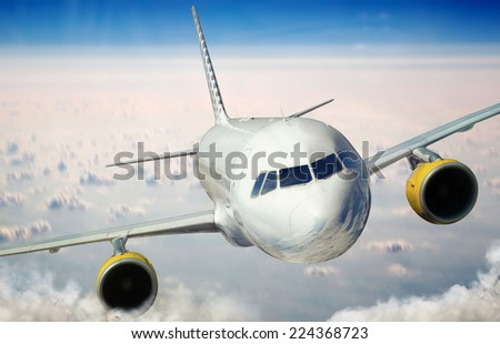 Plane is flying on the sky - stock photo