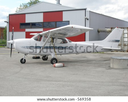 Plane near hangar - stock photo