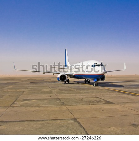 Plane on airfield - stock photo
