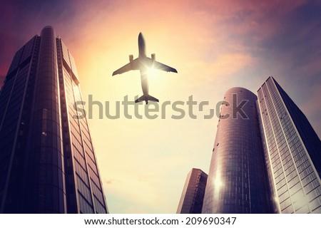 Plane over big city - stock photo