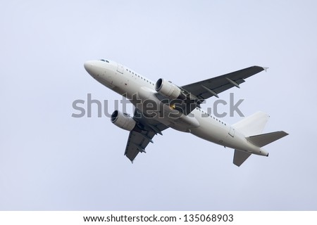Plane taking off to the sky - stock photo