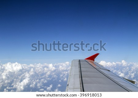 Plane wing on the sky - stock photo