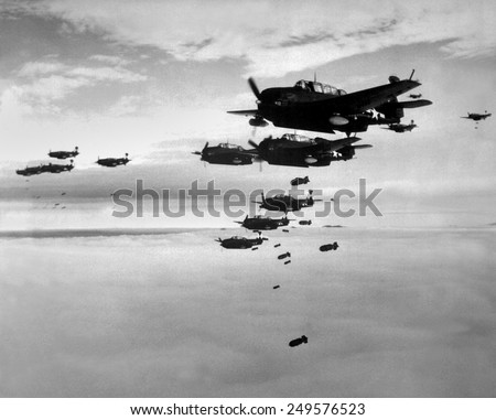Planes from the USS Essex aircraft carrier dropping bombs on Hokadate, Japan, July 1945. World War 2, Pacific Ocean. - stock photo