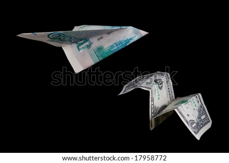 Planes made of Russian and American banknotes - stock photo