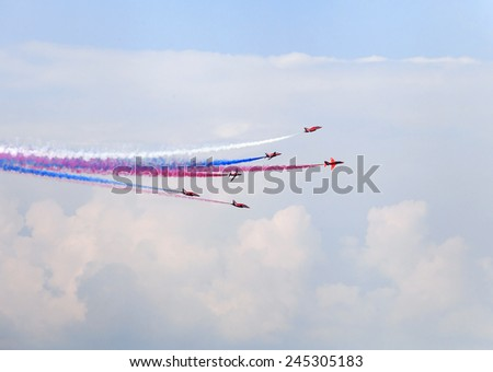 Planes on an air show against cloudy sky - stock photo