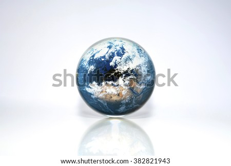 Planet Earth in crystal ball, Elements of this image furnished by NASA - stock photo