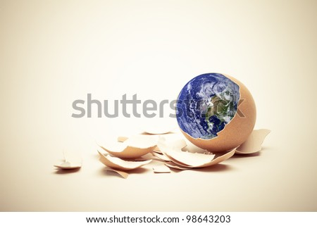 Planet Earth on egg with shell. Conceptual Easter image. Earth in this montage provided by NASA (http://visibleearth.nasa.gov/) - stock photo