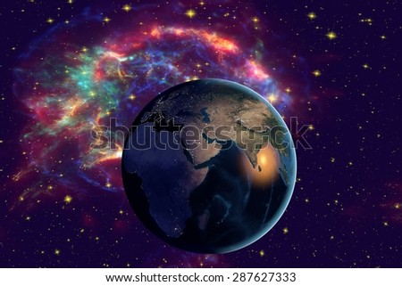 Planet Earth on the background with stars and galaxies; the Earth from space showing India on globe in the night time; elements of this image furnished by NASA - stock photo