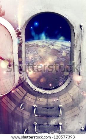 Planet Earth through the window of spaceship.Elements of this image furnished by NASA. - stock photo