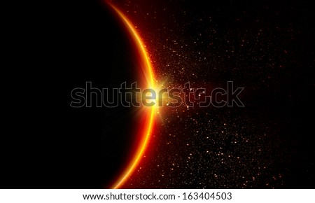Planet Earth with appearing sunbeam light. Sunrise or sunset - stock photo