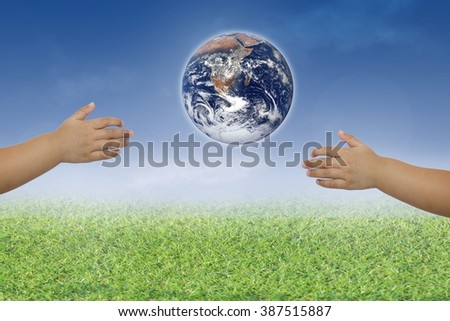 Planet in human hands on blurred beautiful nature background. Investment, Ecology, World Environment Day,Elements of this image furnished by NASA. - stock photo