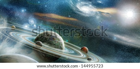Planet in space with numerous prominent ring system and four moons orbit the planet. lit light stars - stock photo