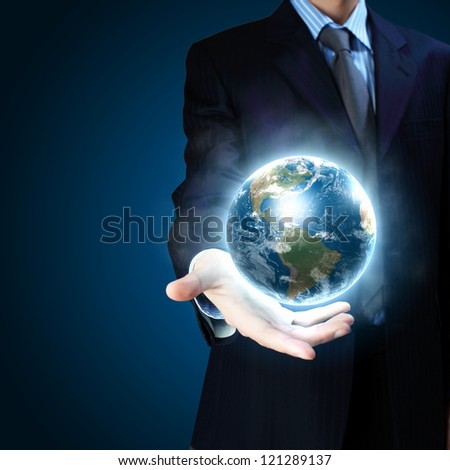 Planet System in Your Hand. Conceptual Image. Elements of this image furnished by NASA. - stock photo