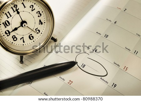 planner book and a pen - stock photo