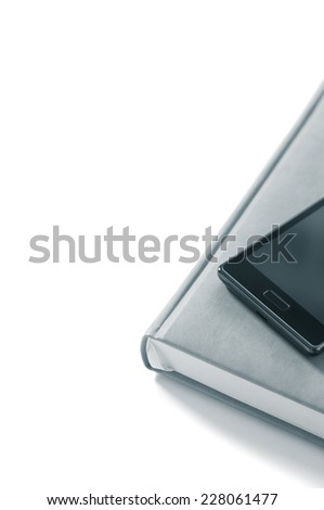 Planner with phone on a white background - stock photo