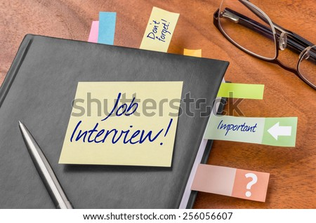 Planner with sticky note - Job interview - stock photo