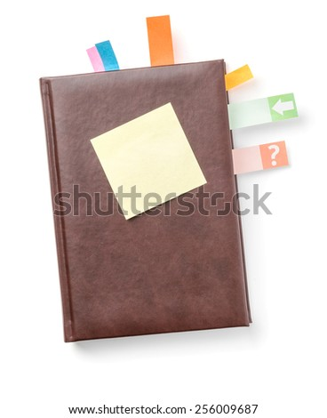 Planner with sticky note on a white background - stock photo