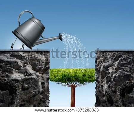 Planning for future success business concept with a businessman and businesswoman lifting a watering can to help a tree grow into a bridge to achieve the long term goal of crossing to the other side. - stock photo