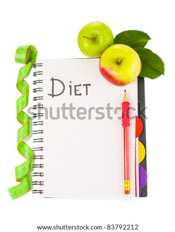 Planning of a diet. Notebook, pencil and fresh apples isolated on white - stock photo