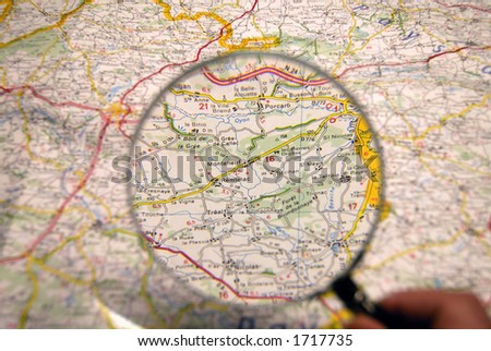 Planning of a journey. Map, magnifier. - stock photo