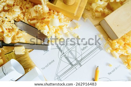 Planning of repair of the house. Woodworking. Drawings for building and working tools on wooden background. - stock photo