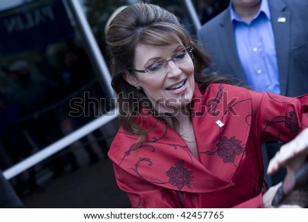 """PLANO, TEXAS - DECEMBER 4:  Former governor Sarah Palin signs autographs while arriving at signing for her book """"Going Rouge"""" in Plano, Texas on December 4, 2009. December 4, 2009 - stock photo"""