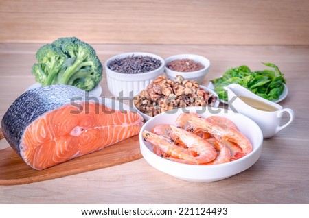 Plant-based and animal sources of Omega-3 acids - stock photo