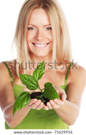 plant in blonde hands close up - stock photo