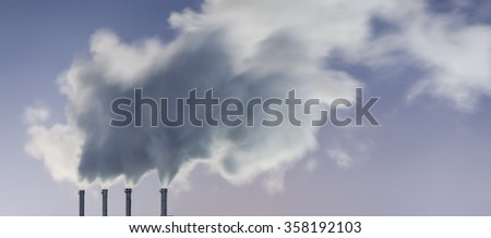 plant pipe with smoke against sky - stock photo