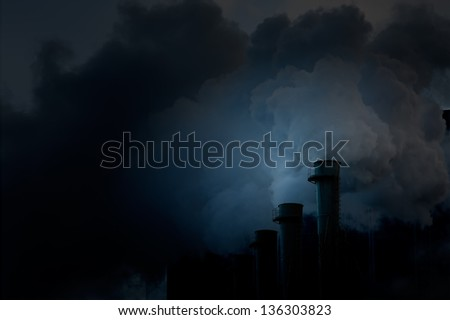Plant's tubes with smoke. Ecocatastrophe - stock photo