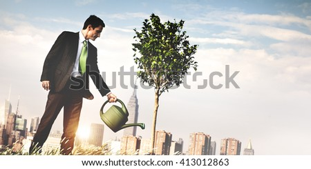 Plant Watering Growth Environmental Conservation Concept - stock photo