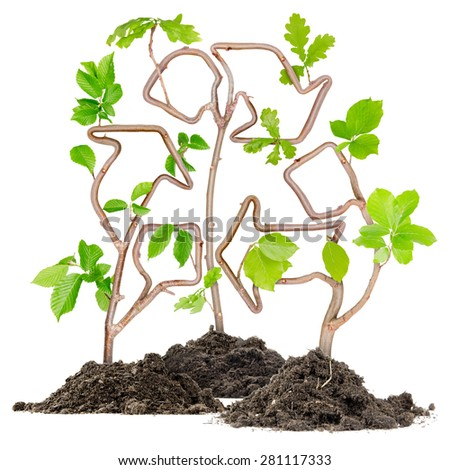 Plants growing from soil heaps forming recycle symbol - stock photo