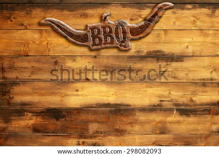 """plaque """"bbq"""" nailed to a wooden board - stock photo"""