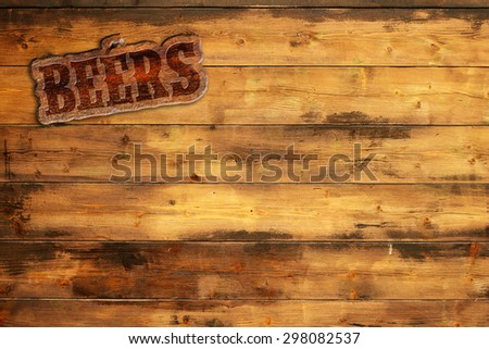 plaque beers nailed to a wooden board - stock photo